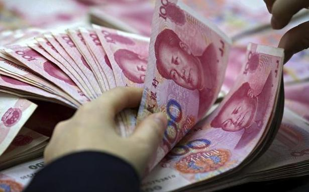 Why has the U.S. accused China of deliberately weakening the yuan?