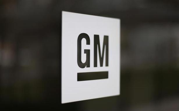 GM hit by chip shortage, to cut production at four plants
