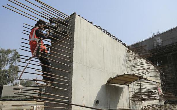 'India on course for 11% growth this fiscal, to meet deficit goal'