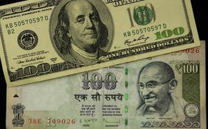 Rupee rises 33 paise to 70.50 against USD in early trade