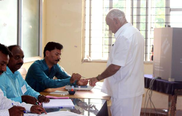 Former Chief Minister and BJP's chief ministerial candidate B.S. Yeddyurappa casts his vote at Shikaripura.