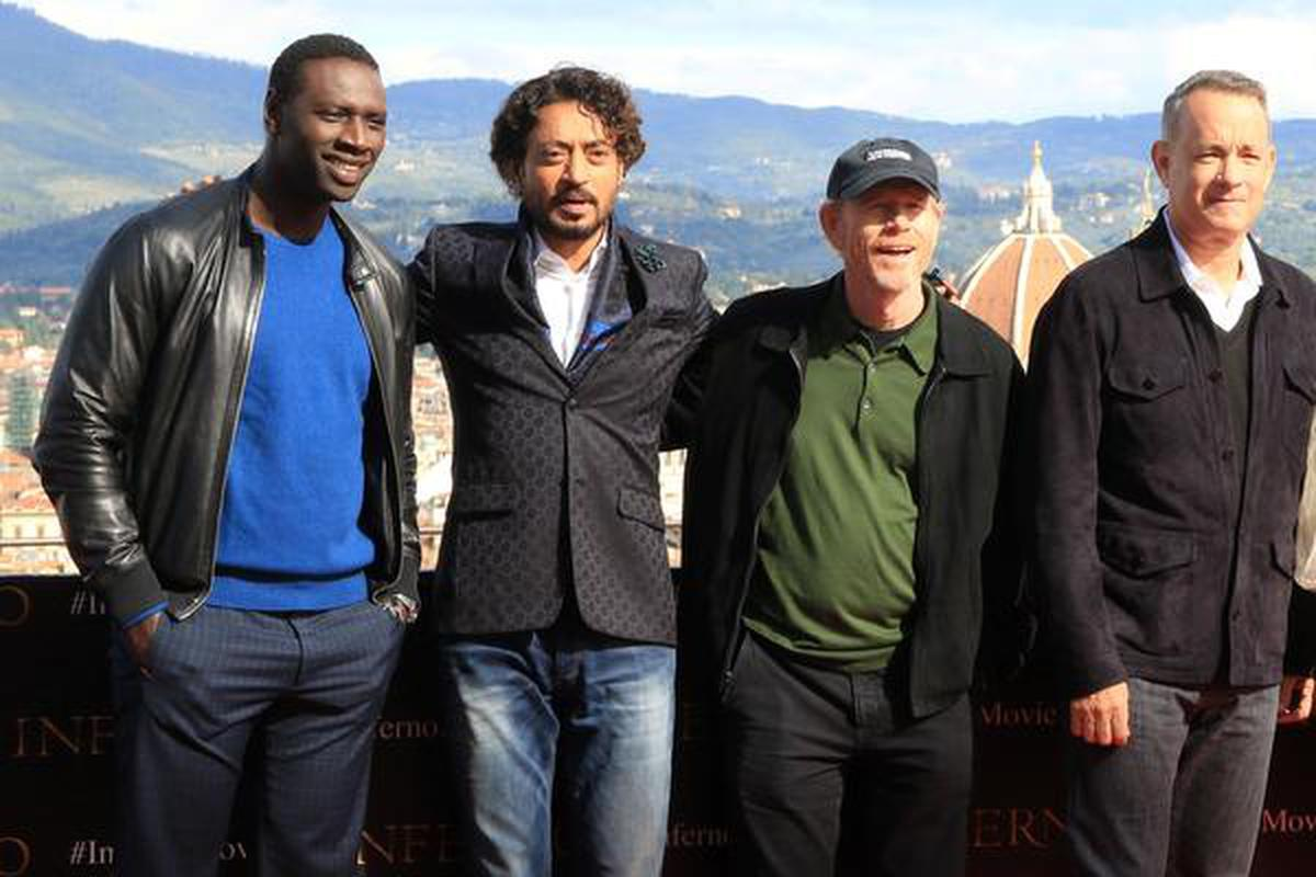 In this file, actors Omar Sy, Irrfan Khan, director Ron Howard and actor Tom Hanks take pictures on October 07, 2016 (L-R) during a photo op on the eve of the film's world premiere