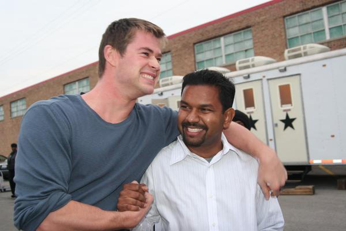 Director Naveen A Chathapuram with actor Chris Hemsworth on the set of 2010 film 'CASH'