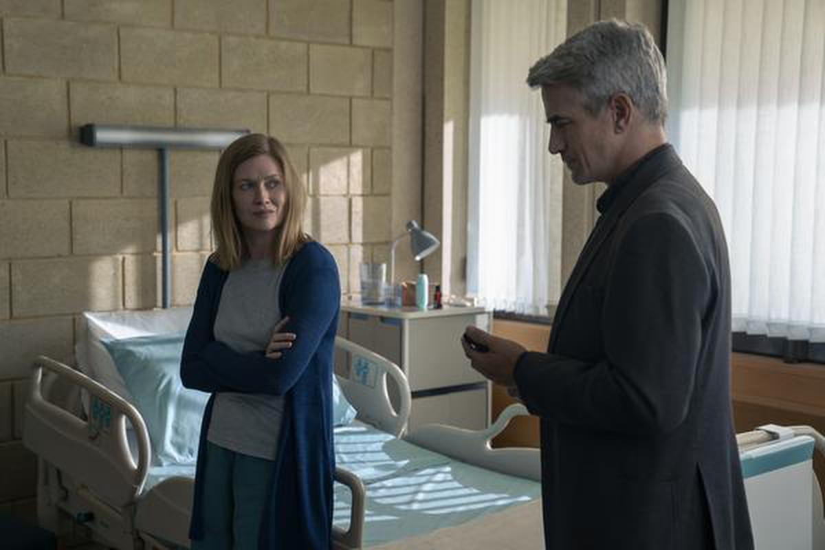 Mireille Enos as Marissa Wiegler, Dermot Mulroney as Carmichael in 'Hanna'