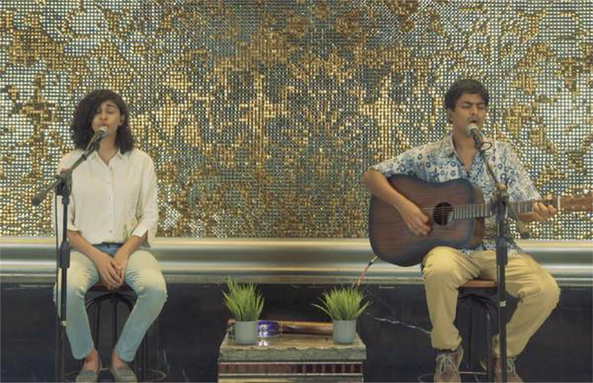 Easy Wanderlings' vocalist Pratika Gopinath and guitarist Sharad Rao performing a set for Circle of Love at Luxe Cinemas in Chennai