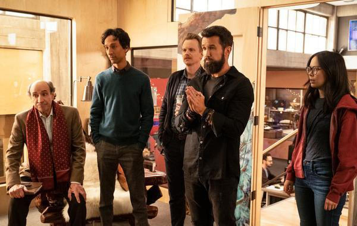 A still of C.W (F Murray Abraham), Brad (Danny Pudi), David (David Hornsby), Ian (Rob McElhenney) and Poppy (Charlotte Nicdao) in a scene from 'Mythic Quest: Raven's Banquet' season 1 episode 1