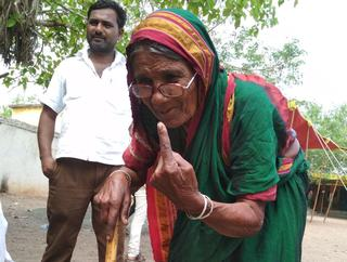 Ghashabi, 95, of Bhimalli village in Gulbarga Dakshin constituency shows her ink-marked finger after casting her vote.