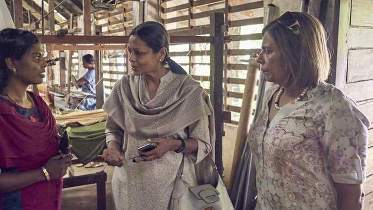 Trustees Meera Mammen (centre) and Minnie Menon (right) with a weaver from C4C