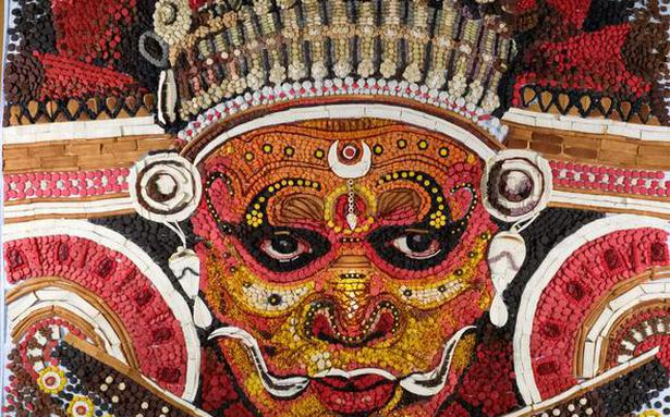 A portrait of Theyyam made with confections