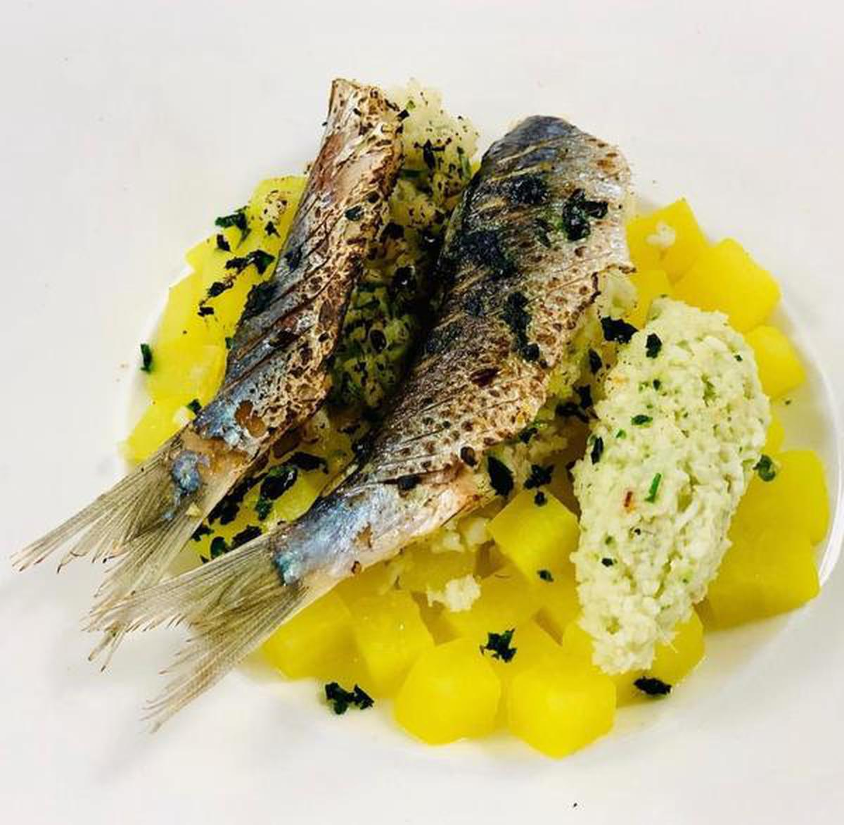 Coconut-stuffed and steamed sardine, colocasia brunoise cooked in turmeric brine liquid and a chutney made of mango, coconut and curry leaves