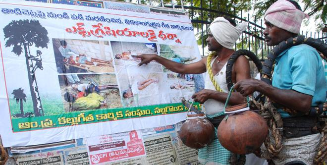 A spirited fight against toddy shops the hindu toddy toppers looking at wall poster before the nalgonda collectorate on monday photo singam thecheapjerseys Image collections