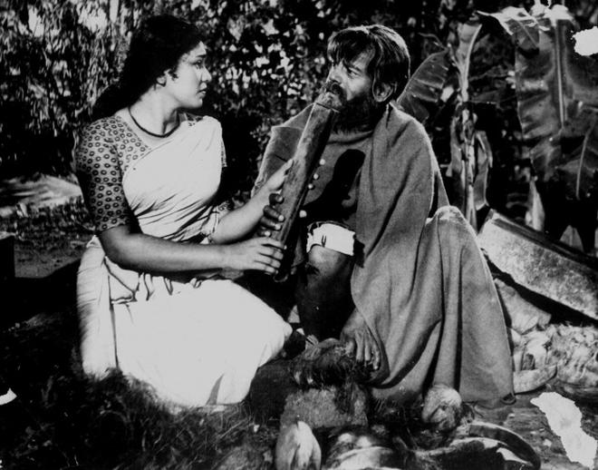 Kaviyoor Ponnamma And Sathyan In A Scene From The Film
