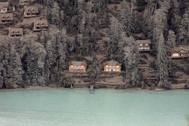 Houses and trees are covered by volcanic ash on the bank of Nahuel Huapi  Lake in 48ddf17cb8c5