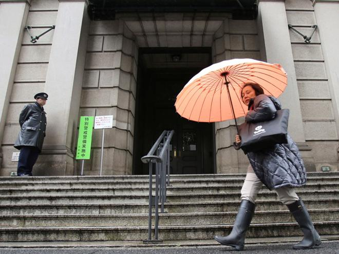 Japan introduces negative interest rate to boost economy the hindu a woman walks past in front of bank of japan friday jan 29 fandeluxe Image collections