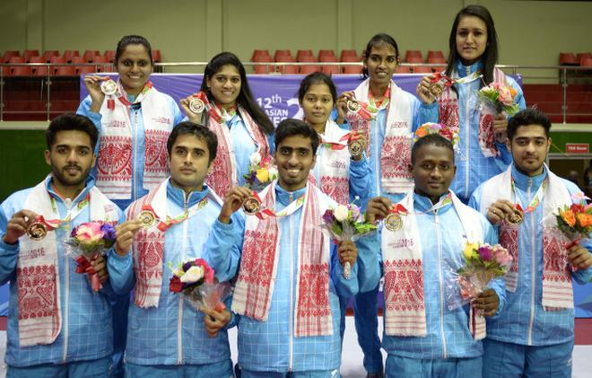 The Indian men's and women's table tennis teams which won the gold with  easy victories in