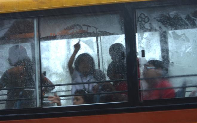 Students On Their Way To School In The Rain. Photo:Thulasi Kakkat