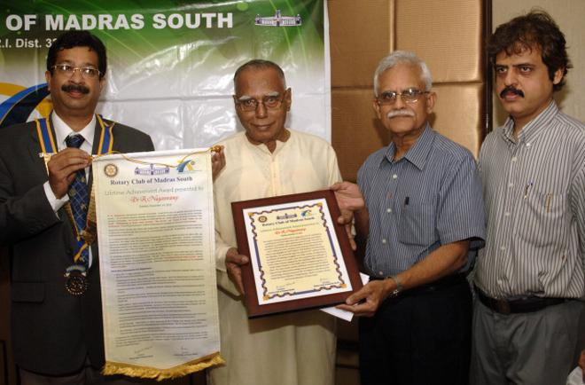 HONOUR: Former president of the Rotary club of Madras South Ramakrishna Raja (second from right), presenting the 'Lifetime Achievement Award' to archaeologist Nagaswamy (second from left), at a function in Chennai on Tuesday. Rotary Club president Mukund Vedapudi (left) and secretary Jawaharlal Nichani, are in the picture. Photo: K.V.Srinivasan
