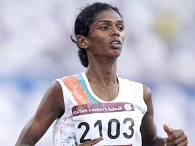 up and running santhi crosses the finish line in an event at the 2006 asian