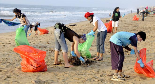Image result for cleaning up the beach