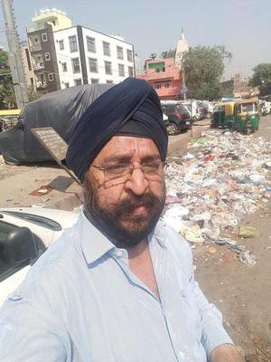 "East Delhi Residents' Welfare Association Joint Front president B.S. Vohra took a selfie opposite Rashid Market in Laxmi Nagar on September 29 as part of his 'Selfie with Garbage"" campaign."