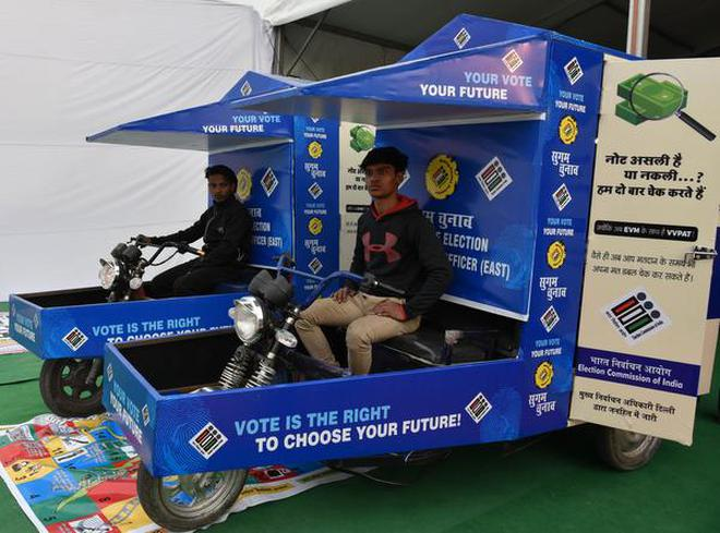 Image result for e-rickshaw with evm machine