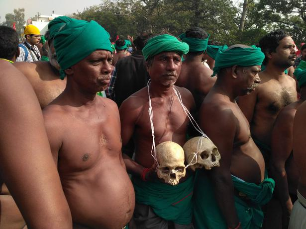 Farmers bearing skulls of relatives who have committed suicide due to farm distress take part in the rally on Friday.