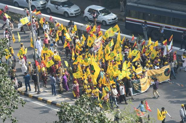 Farmers rally passes by Connaught Place in New Delhi on Friday.