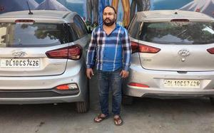 Man uses same registration number on two cars, held