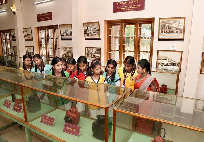 Students looking at exhibits during a visit to at Rail Museum organised as part of World Heritage Day in Tiruchi on Wednesday.