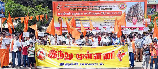 Members of the Hindu Munnani staging a demonstration at Tiruchi on Sunday demanding the withdrawal of darshan ticket system in temples.