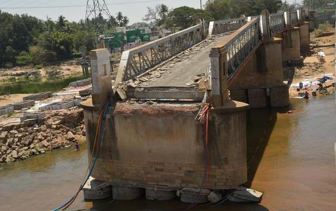 A view of the old bridge across the Coleroon River in Tiruchi.
