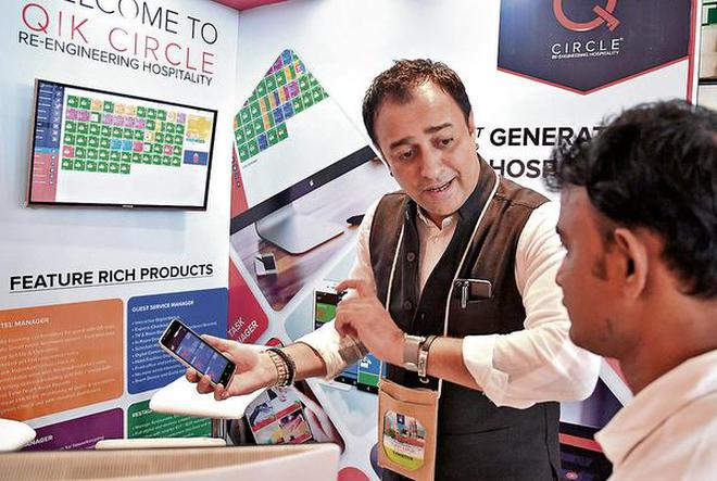 QiK Cricle CEO Tubby Kapoor demonstrating an app at the 34 th convention of IATO, in Visakhapatnam.