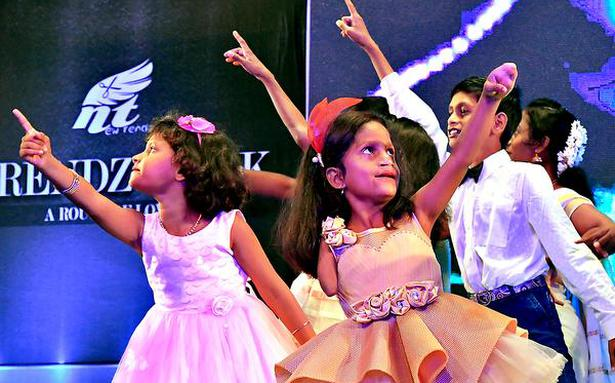 Disability no concern, as kids walk the ramp