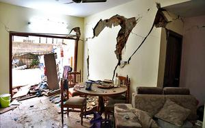 Building collapse: With exits blocked, families escape through windows