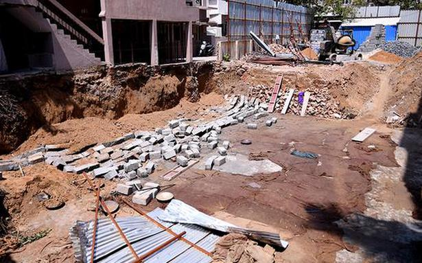 Woman dies in wall collapse