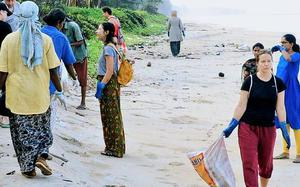Tourists lend a hand, take part in cleaning drive