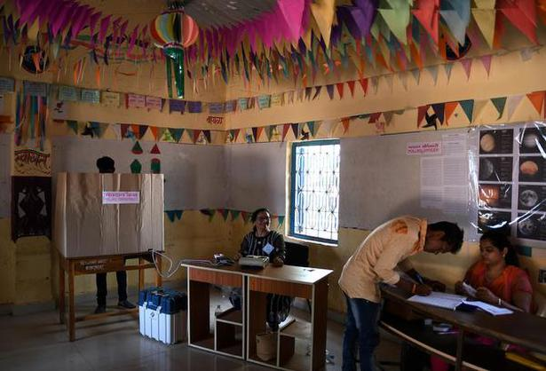 Mumbai: May 28, 2018. The poling officer helping the voters at Kavada-ThakarPada village in Talasari Taluka of Palghar district on Monday. The by-election for Lok Sabha seat in Palghar of Maharashtra being conducted today. Photo: Arunangsu Roy Chowdhury.