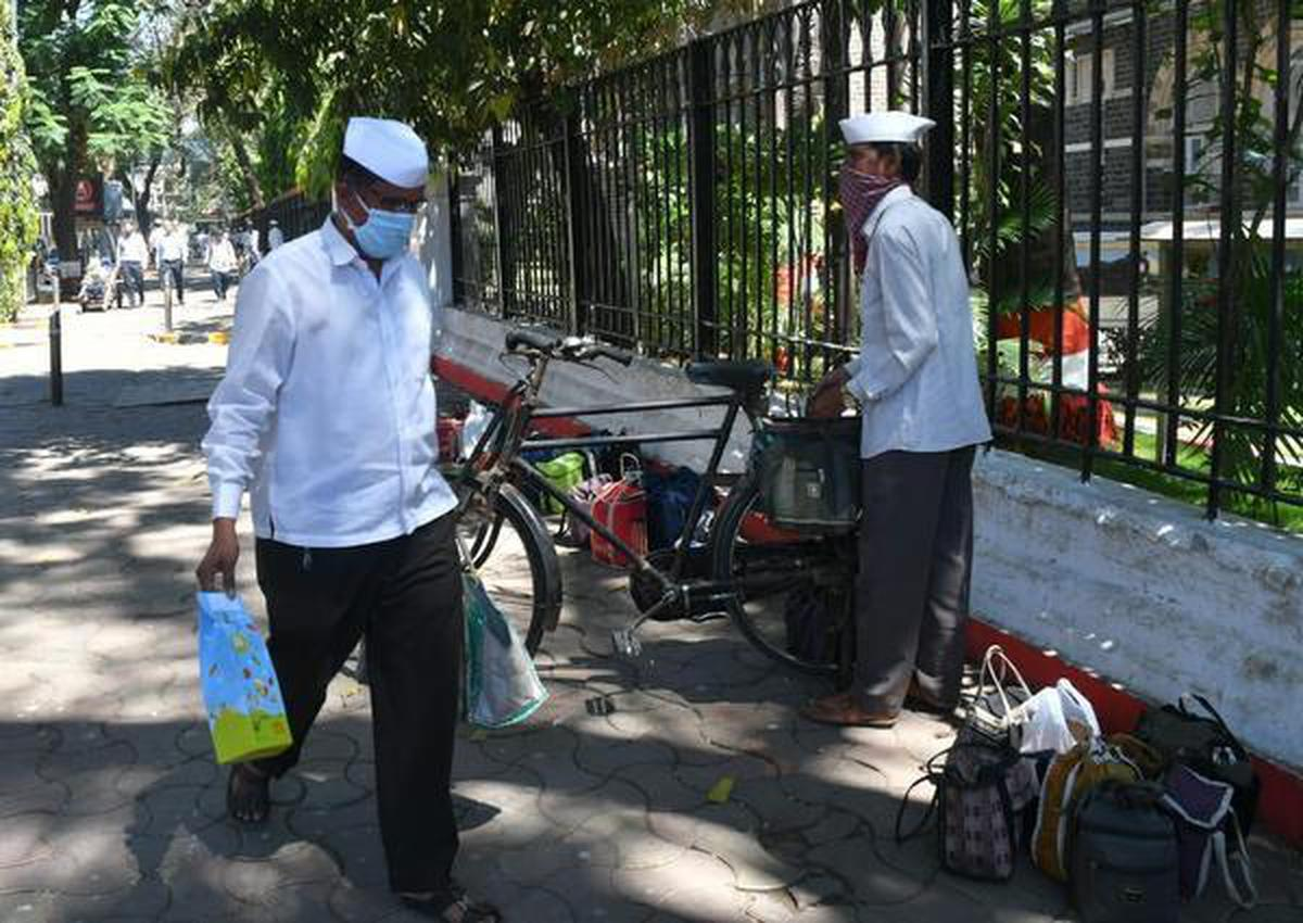 Mumbai's dabbawalas seen wearing masks in front of Churghate station on Thursday.