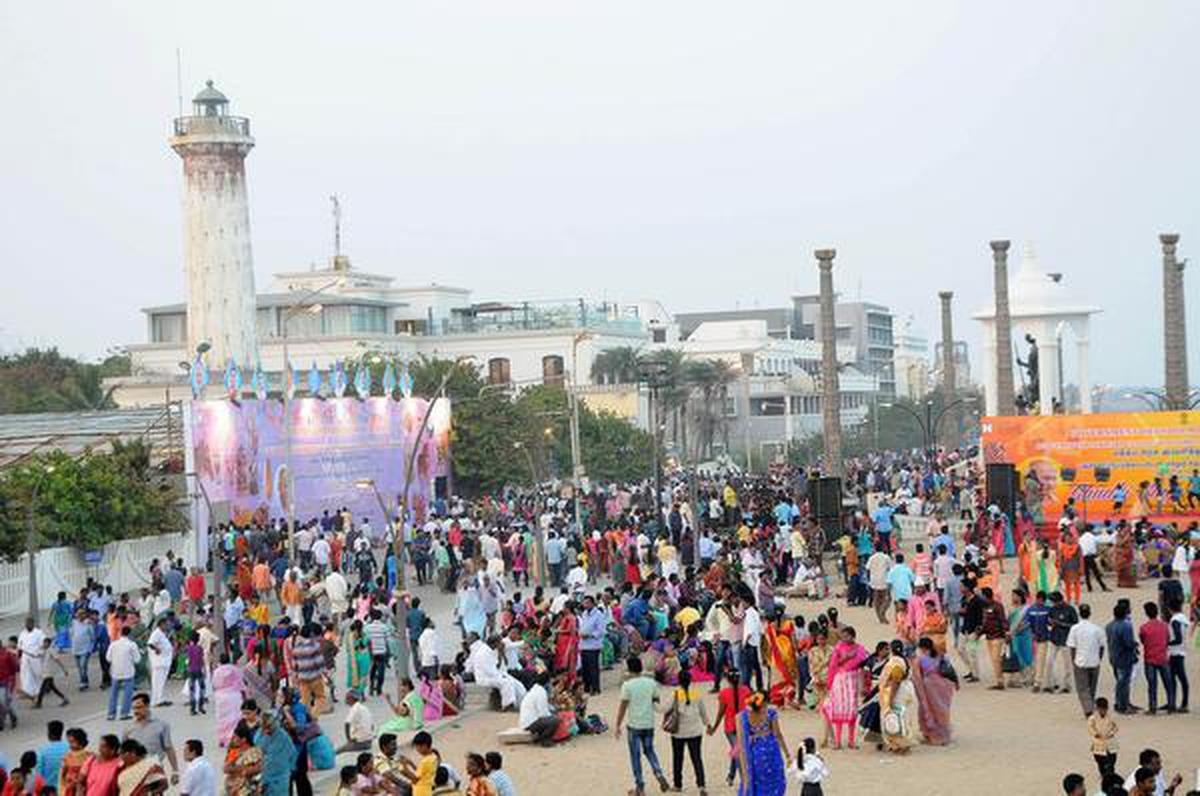 Crowds throng the beach, parks