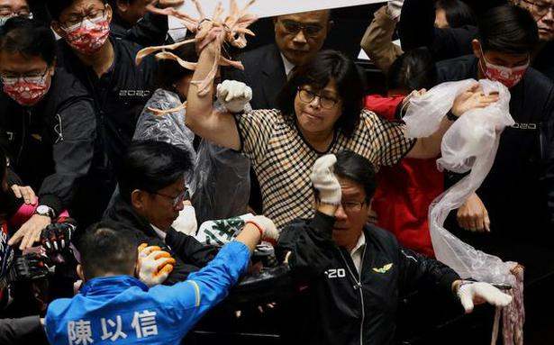 Fists and pig guts fly in Taiwan Parliament during debate on U.S. pork