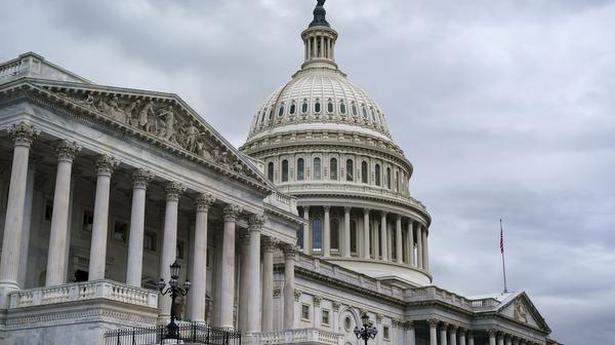 U.S. Congress averts default with stop-gap debt limit hike