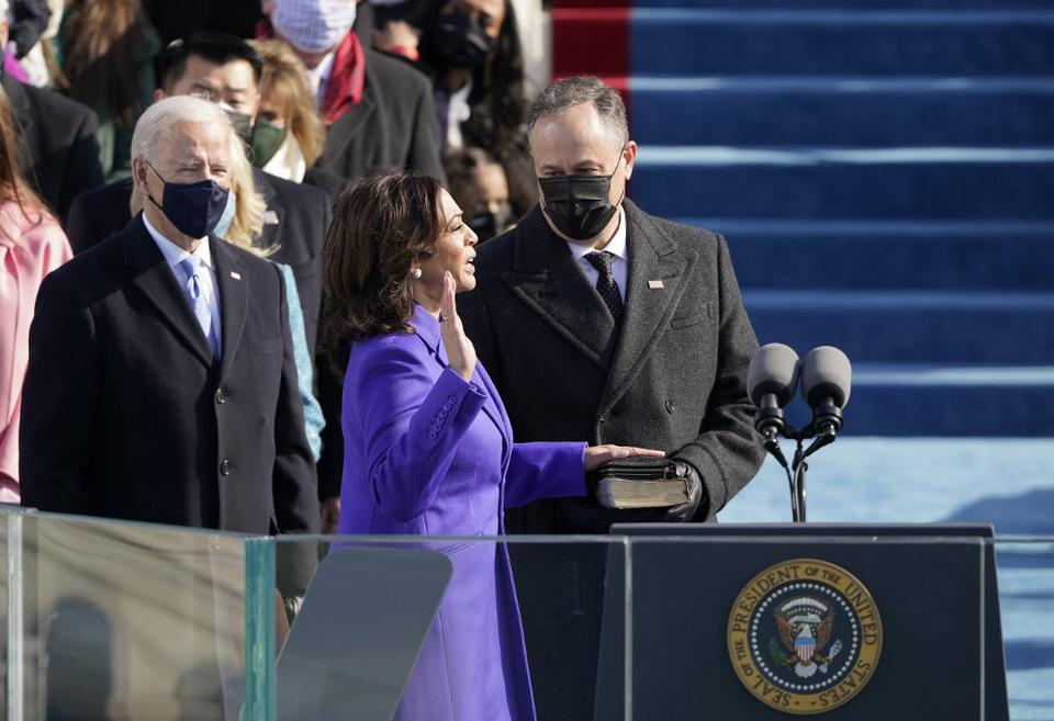 Kamala Harris is sworn in as Vice-President by Supreme Court Justice Sonia Sotomayor as her husband U.S. Second Gentleman Doug Emhoff holds the Bible during the inauguration of Joe Biden as the 46th US President on January 20, 2021 at the U.S. Capitol in Washington D.C.