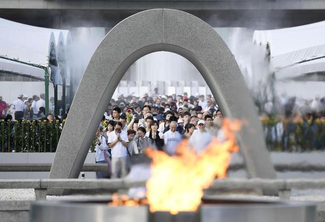 People offer prayers at the Peace Memorial Park in Hiroshima, western Japan, to mark the 72nd anniversary of the world's first atomic bombing that killed ...