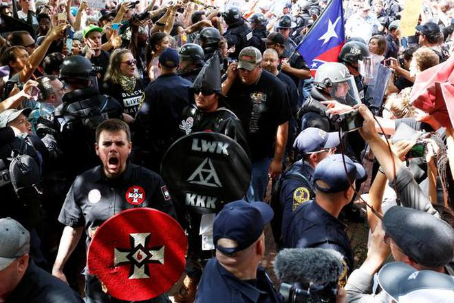 Image result for photos of political rallies where 2 sides are facing off