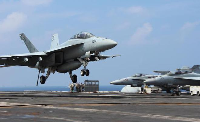 In This October 17, 2015 File Photo, US Navyu0027s F 18 Aircraft Lands On  Aircraft Carrier USS Theodore Roosevelt During The U0027Malabaru0027 Exercise With  The Indian ...