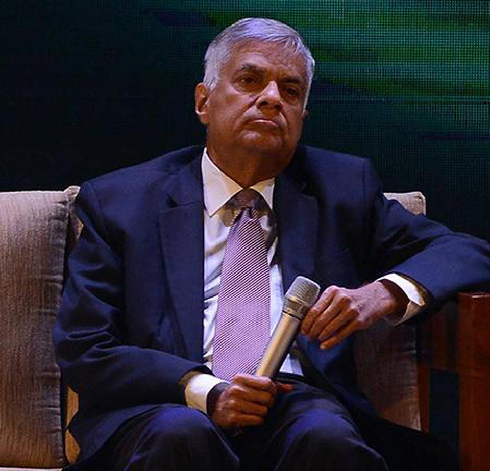 Ranil presents interim report on new Constitution