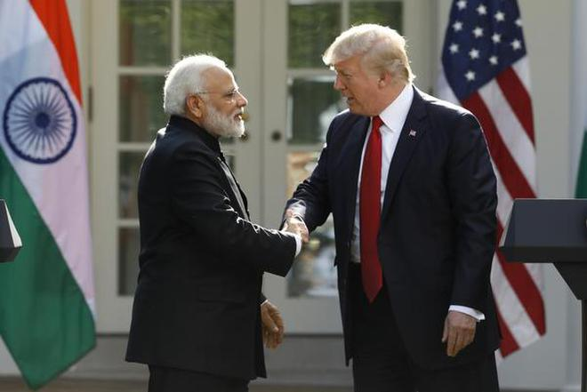 U.S. President Donald Trump greets Indian Prime Minister Narendra Modi during their joint news conference in the Rose Garden of the White House in Washington, U.S. (File Photo)