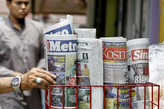 Malaysia proposes 10 years in jail for fake news the hindu a man takes a copy of newspaper at a grocery shop in shah alam malaysia fandeluxe Image collections