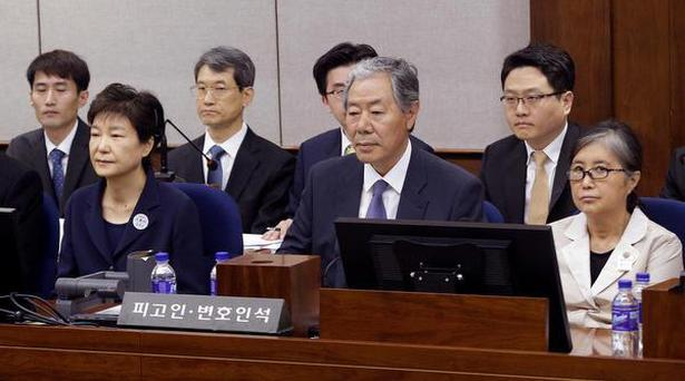 Former South Korean President Park Geun-hye, front left, sits with her longtime friend Choi Soon-sil, right, for her trial at the Seoul Central District Court in Seoul on May 23, 2017.