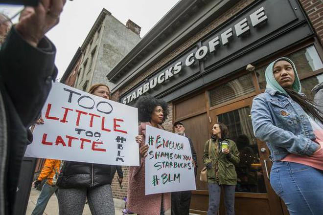 Protesters gather outside of a Starbucks in Philadelphia, Sunday, April 15,  2018,